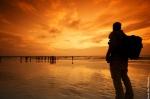 traveller-man-photographer-thinking-sea